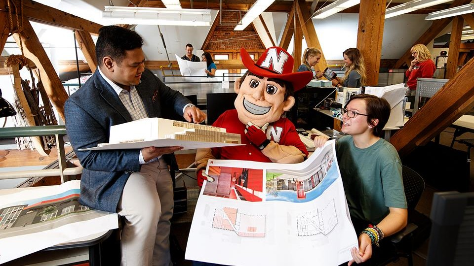 Herbie Husker examines building plans in an Architecture Hall lab space. This image is part of the Nebraska Alumni Association's 2018 calendar.