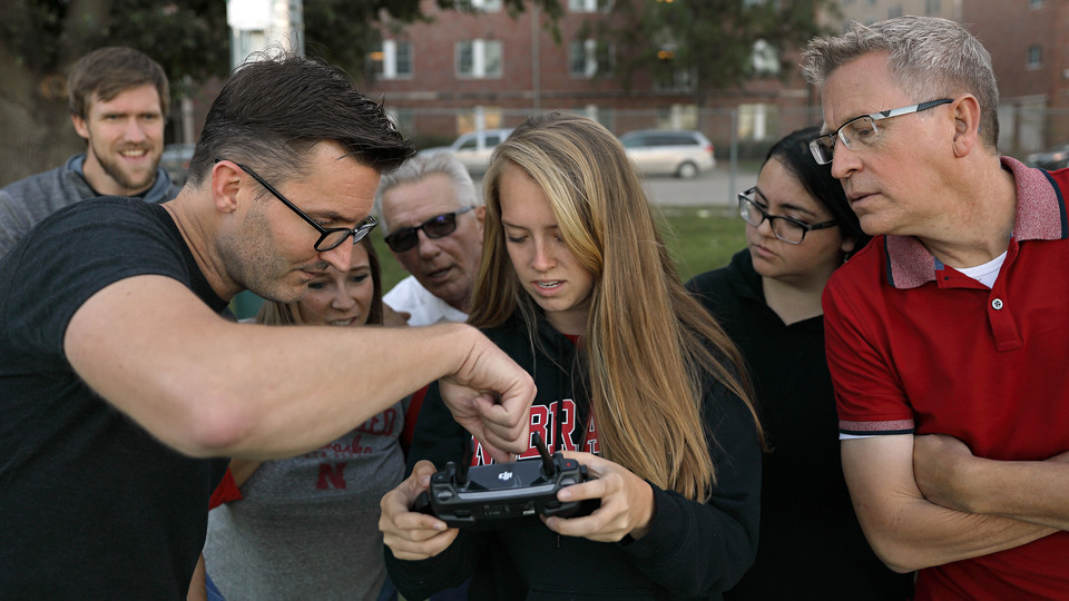 Nebraska's Matt Waite (second from left) works with students in a drone journalism pop-up course offered in fall 2018.