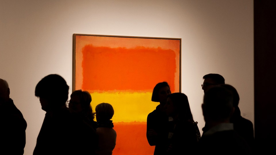 "Visitors examine Mark Rothko's ""Yellow Band,"" which is part of Sheldon Museum of Art's permanent collection."