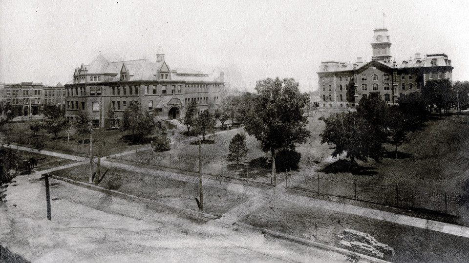 Looking north from R Street, this undated photo shows two of the earliest buildings on the University of Nebraska's original four-block campus — Architecture Hall (at left), which was originally a library, and University Hall (right). University Hall, the first building on campus, was demolished in 1948. Architecture Hall, built in 1892, is the oldest structure on campus.