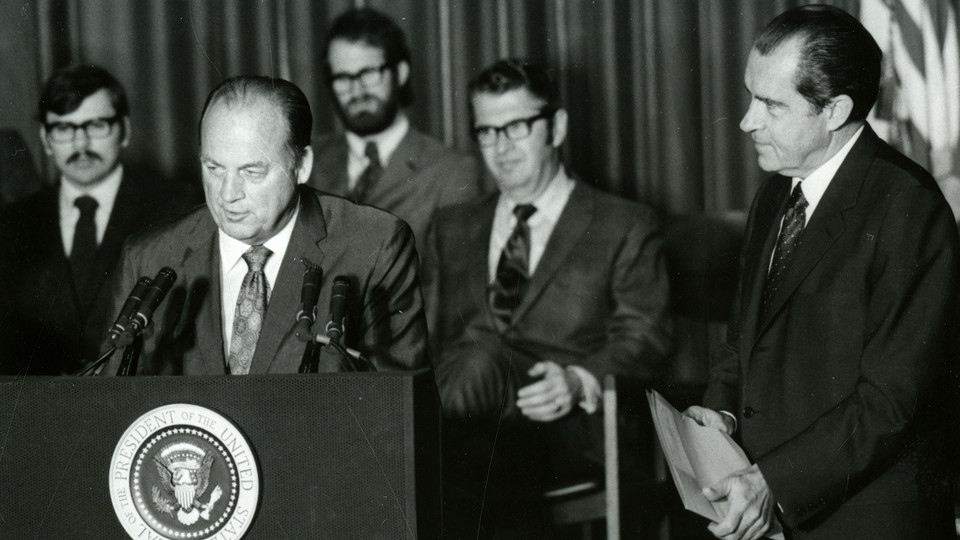 Bob Devaney, then head coach of Husker football, talks after his national championship team was honored by President Richard Nixon (right) during a Jan. 14, 1971 celebration in the Coliseum. Also pictured in the background (seated between Devaney and Nixon) is Joseph Soshnik, the university's 13th chancellor.