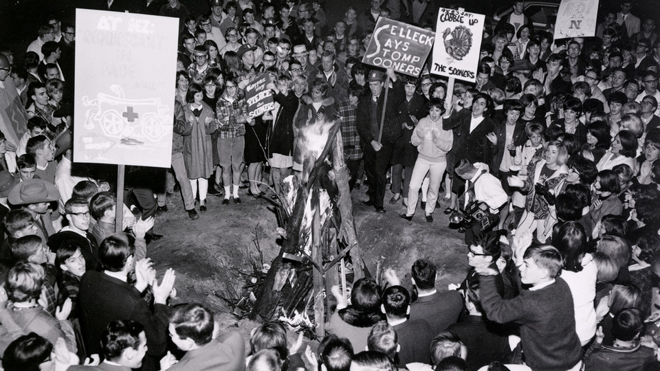 Students rally around a bonfire during a 1966 homecoming celebration held near the Nebraska Union.