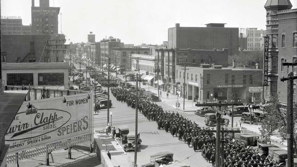 Nebraska graduates parade through downtown Lincoln at the corner of 13th and Q streets in this undated photo taken from atop the Temple Building.