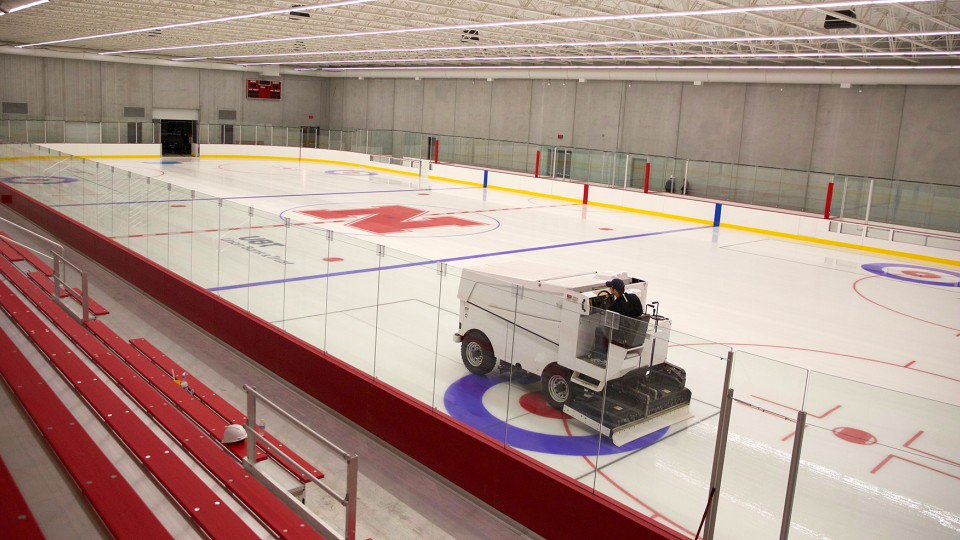 Chris Margiotta, general manager, drives a Zamboni across the rink in the John Breslow Ice Hockey Center. The facility, which is the university's first indoor sheet of ice, opened Dec. 15, 2015.