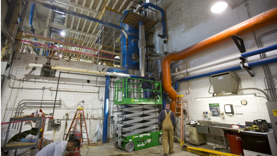 Maintenance crews begin work that will allow for the replacement of the boiler deaerator (large, blue strucutre at top, center) in the City Campus utility plant.
