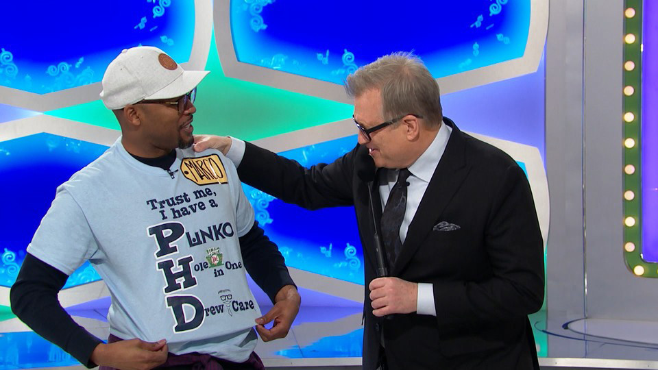Marco Barker shows 'The Price is Right' host Drew Carey what Ph.D. really stands for.