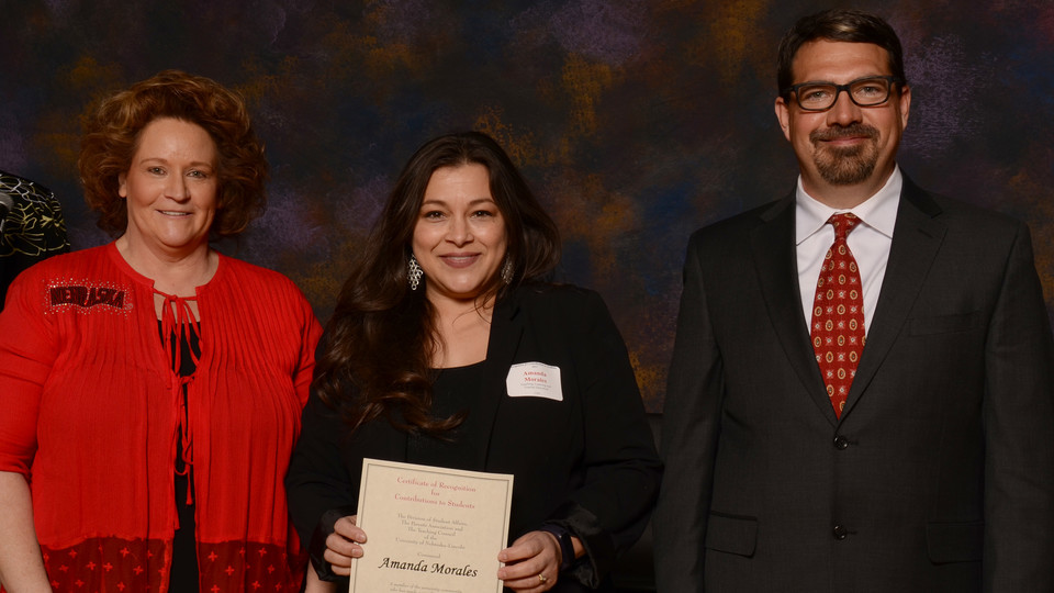 Amanda Morales (center) receives her first Parents' Recognition Award from (right) Scott Napolitano, teaching council chair and assistant professor of practice in educational psychology, and Linette Asay, UNL Parents Association president.