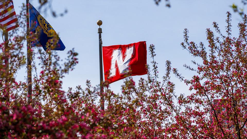 Nebraska flag flying over campus