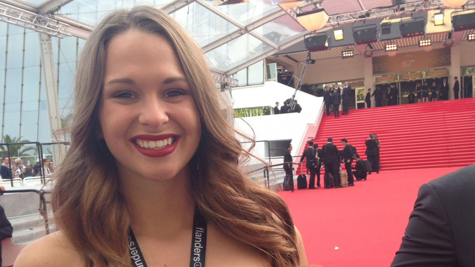 Aliza Brugger stands on the red carpet at the 2014 Cannes Film Festival. She is the first UNL student to have a film screened at the international festival.