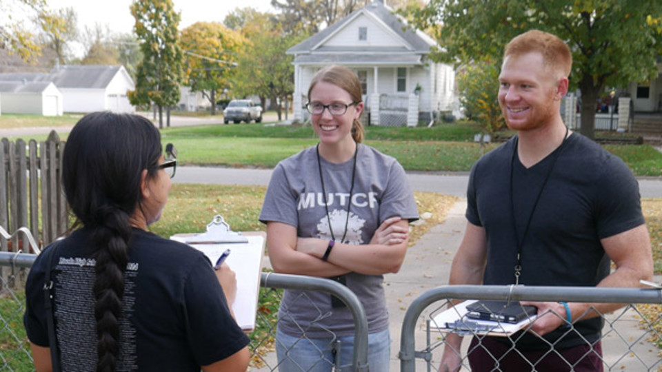 Nebraska graduate students conduct a door-to-door survey of Lincoln residents. The survey results were used to create a database that can be used by community planners for neighborhood improvements.