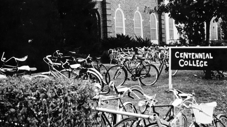 Bikes sit in racks outside Centennial College buildings. The college is a focus of the next Nebraska Lecture on Oct. 12.