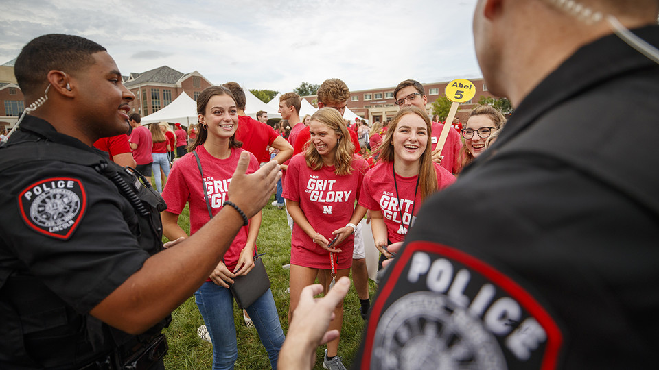 Officers from Nebraska's University Police Department interact with students at a back-to-school event last August.