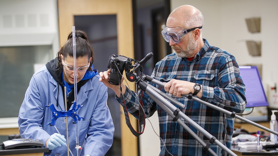 Jessica Periago (left) and Kurt Wulser (right) film an experiment for chemistry students. The videos are replacing hands-on labs the students were scheduled to complete during the spring semester.