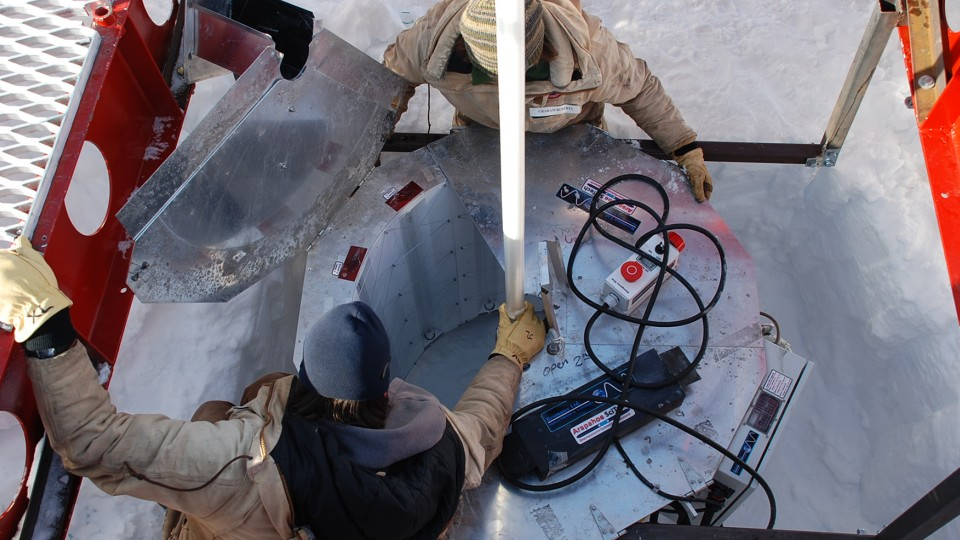 The WISSARD research team set up an ultraviolet light collar at the top of the bore hole in Antarctica.