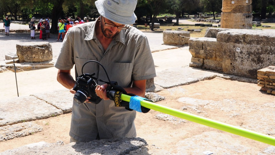 UNL's Philip Sapirstein takes digital photos of the Temple of Hera in Olympia, Greece. Sapirstein is combining digital photography with computer software to generate realistic 3-D models of ancient Greek architecture.