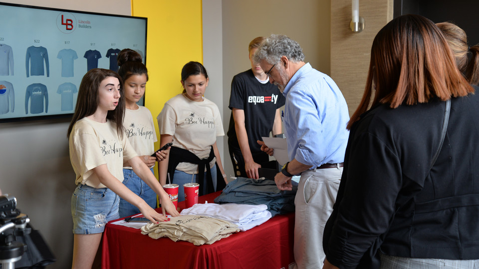 Students participating in the Future Builders Challenge sell their T-shirts during a June 21 pop-up event at The Foundry in downtown Lincoln.
