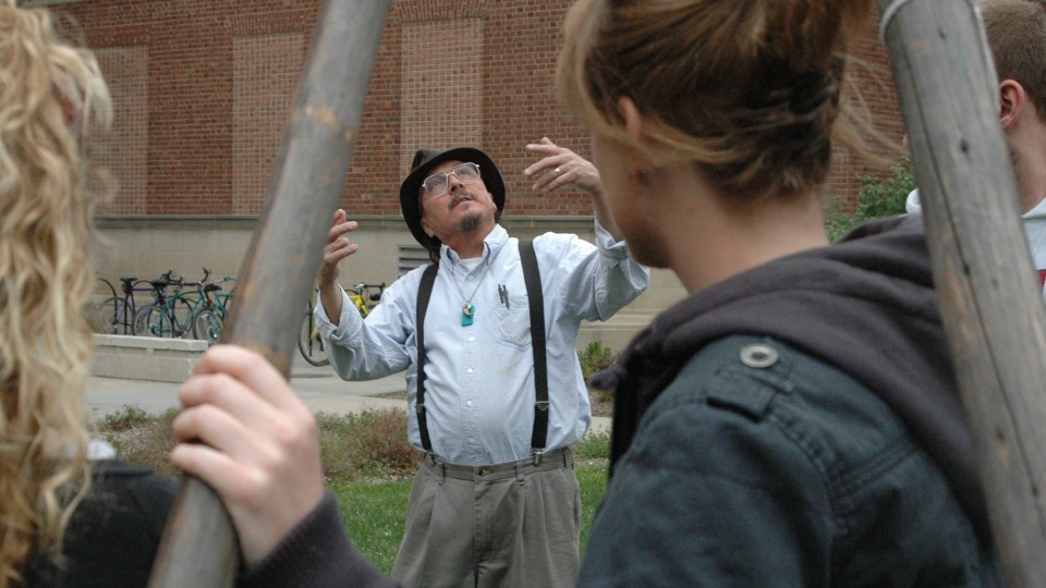 UNL's Mark Awakuni-Swetland gestures as he talks to students during a tipi set-up day outside of Oldfather Hall.