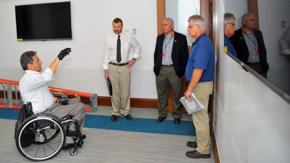 Lance Pérez (from left) talks with UNL's Chad Lea, Mark Miller and Dale Bowder in the virtual life sciencs lab on the second floor of Brace Laboratory on Aug. 18.  The building reopens Aug. 25 after an $8 million renovation.