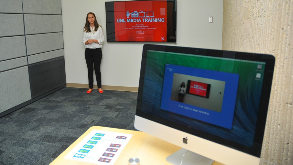 Lexie Heinle, a junior journalism major, uses the UNL One Button Studio on Aug. 26. The new studio in Love Library offers video recording with a single click of a button.