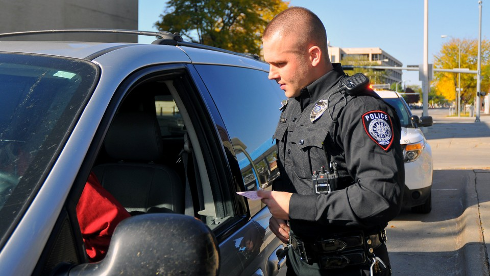 Officer Eric Fischer talks with a driver during a routine traffic stop. The UNL Police Department has received accreditation after a three-year review by the Commission  on Accreditation for Law Enforcement Agencies.
