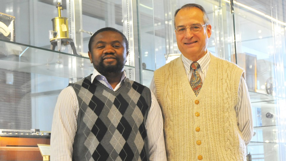 Jean Marcel Ngoko Djiokap (left) and Anthony Starace are co-authors on a study that identified the characteristics of a laser pulse that yields electron behavior they can predict and control.