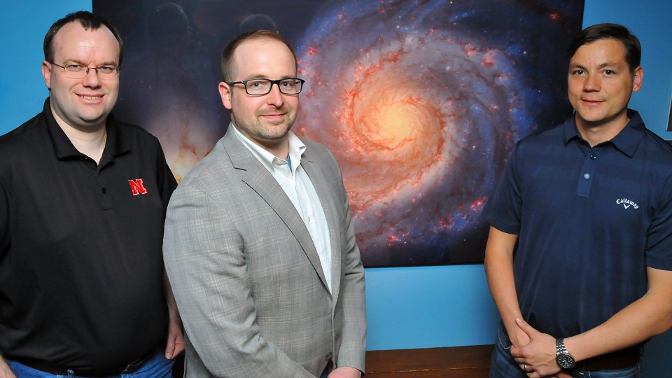 A research team that includes (from left) Peter Harms, Adam Vanhove and Mitchel Herian is helping NASA measure how lengthy space flights will effect the mental wellbeing of astronauts.