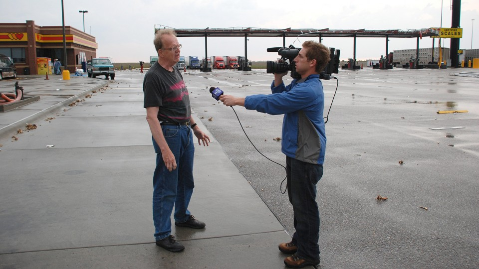 UNL's Ken Dewey (left) being interviewed at a truck stop following a 2008 storm in Nebraska. Dewey is a professor of climatology in the School of Natural Resources.
