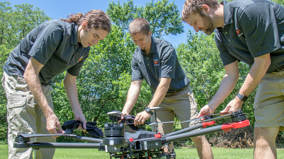 Evan Beachly (from left), Jim Higgins and Carrick Detweiler assemble a drone system before taking it for a test flight. The system features a software application that makes it easy to operate. It can also be flown at night, helping crews safely fight fires despite limited visibility.
