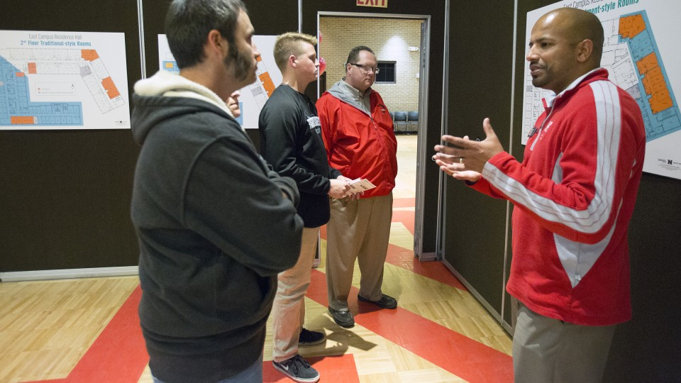 Steve Jara of University Housing (right) talks with (from left) Pat O'Neill, Tiffany O'Neill (partially hidden), Todd Seifert and Josh Seifert during the Nov. 17 East Campus residence hall open house.