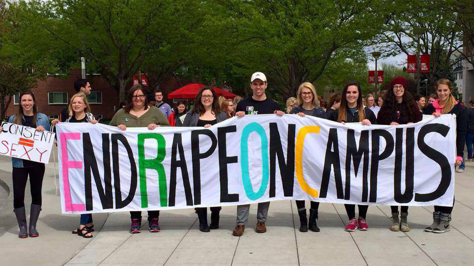 Students pose with a banner during the 2016 End Rape on Campus March at the University of Nebraska–Lincoln.