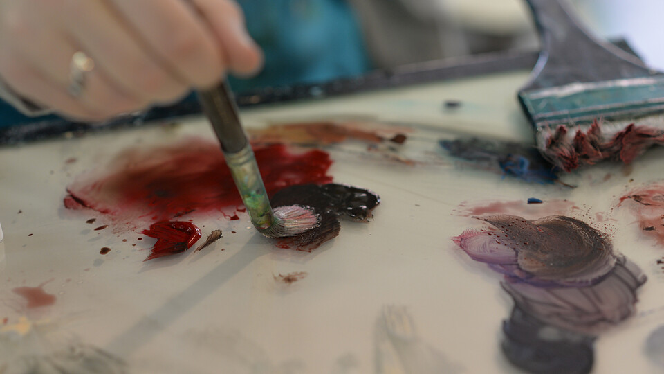 """Students will have the opportunity to come to the Meier Commons, just north of the Nebraska Union, from 9 a.m. to 4 p.m. April 26, to contribute a paint stroke to a painting to build community in a project titled """"The Human Connection."""""""