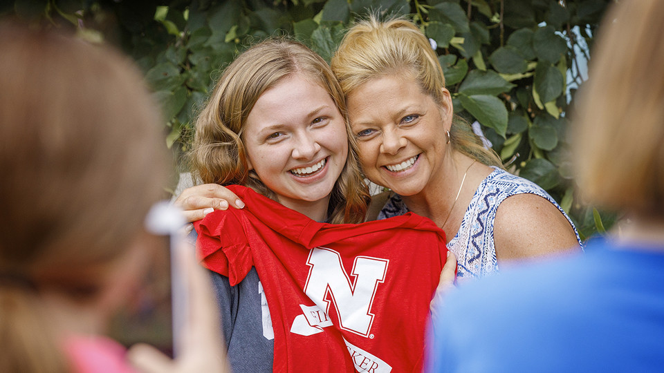 A freshman student displays her First Husker shirt during a back-to-school event in August. The event celebrated students who are the first in their family to go to college.