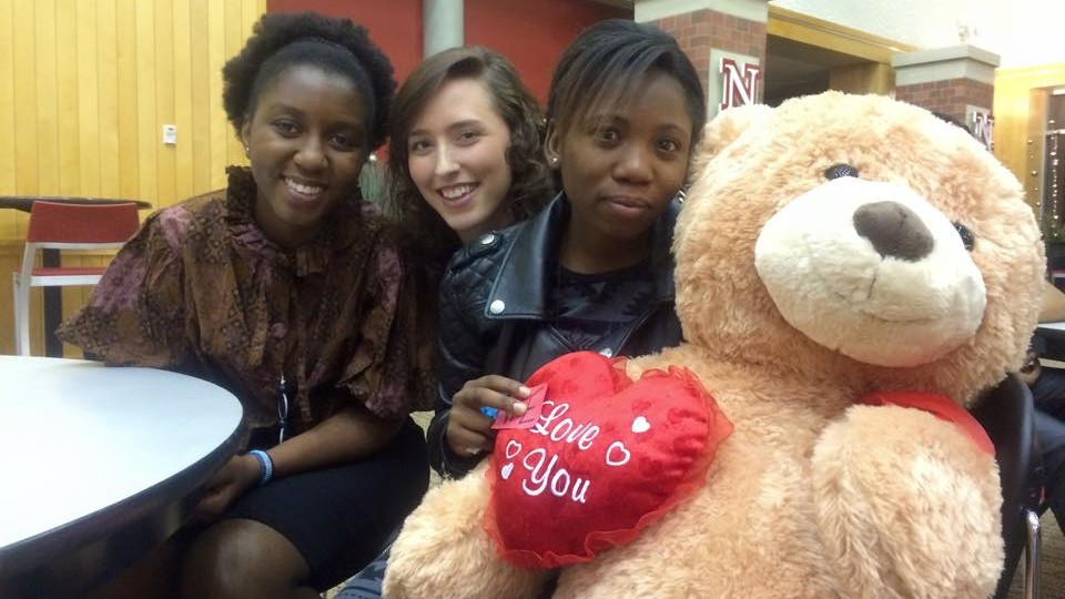 Grace Abraham (right) with a tedy bear given to her by classmates at Nebraska.
