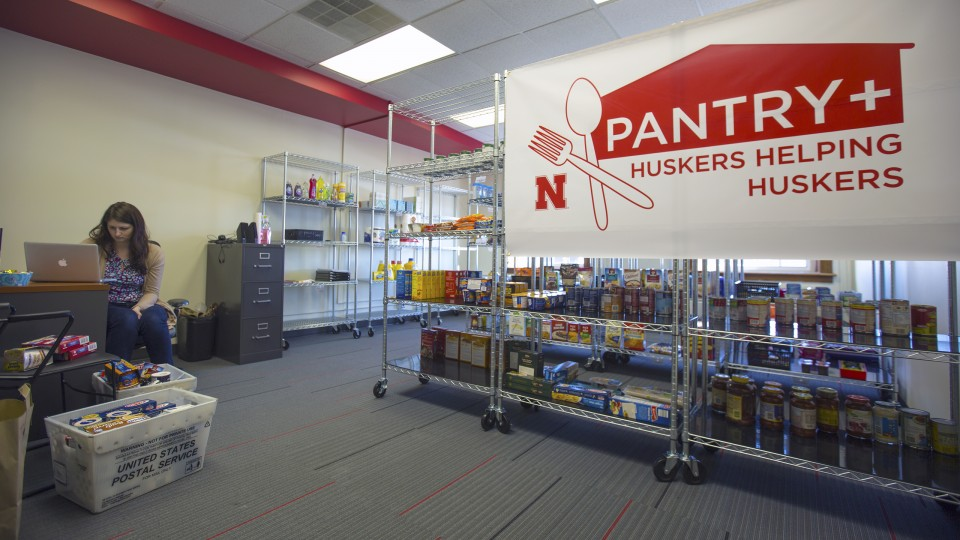 Jessica Lanctot, a graduate assistant, prepares items in the Huskers Helping Huskers Pantry+ on Jan. 6. The pantry, which will offer food, other necessities, housing assistance and financial counseling to students, opens Jan. 9 in the Nebraska Union.