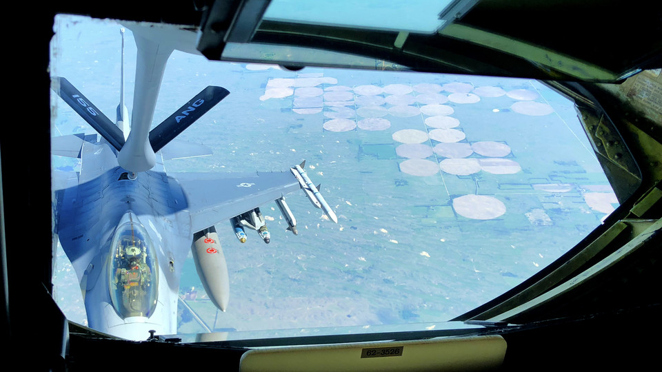 An South Dakota National Guard F-16 refuels at 35,000 feet over the Cornhusker State during the May 24 civic leader flight led by Nebraska's 155th Air Refueling Wing.