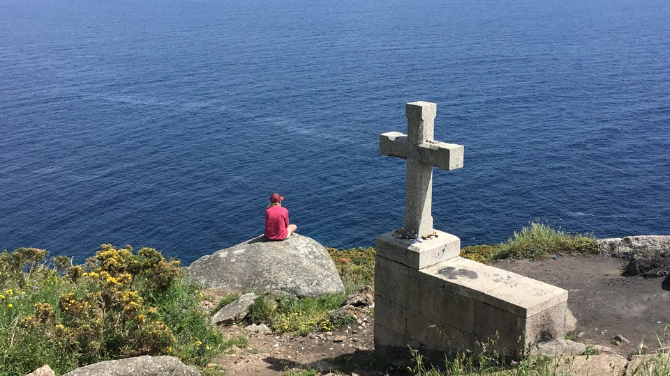 Nebraska's Tori Tyron looks out across the Atlantic Ocean at the end of the Camino de Santiago pilgrimage.