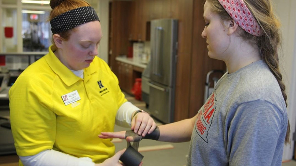 Nebraska's athletic training majors gain hands-on experience and employ academic knowledge working as student employees in Campus Recreation's injury prevention and care program.