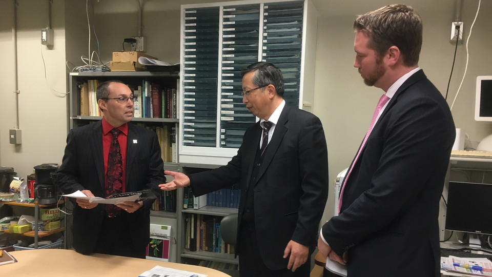 Nebraska's Steve Goddard (left) and Jon Kerrigan (right) meet with a Japanese colleague during an international trade mission in early February.