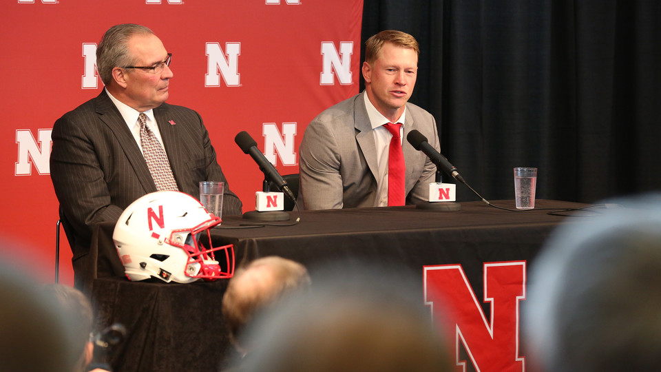 Scott Frost (right) talks with media in Memorial Stadium after being announced as Nebraska football's 30th head coach on Dec. 3. Bill Moos (left), athletic director, introduced Frost during the event.