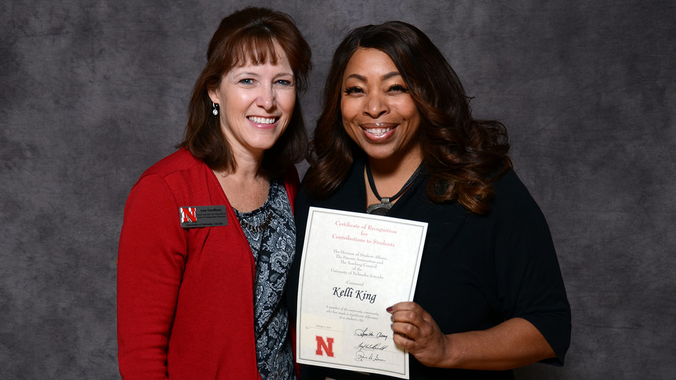 Kelli King (right), director of the William H. Thompson Learning Community, accepts her Parents' Recognition Award from Amy Goodburn, senior associate vice chancellor and dean of undergraduate education, during the Parents' Recognition Awards on Feb. 2. More than 228 faculty and staff were honored for their support of Nebraska students.