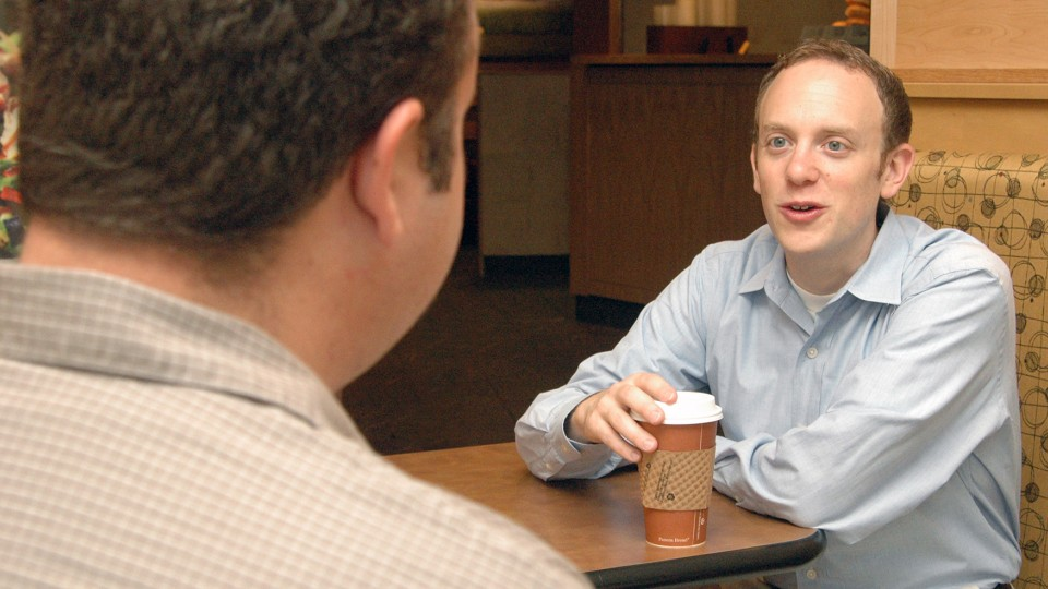 UNL's Ari Kohen, right, speaks with a student in this file photo.