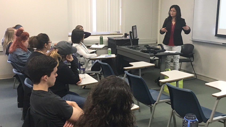 Nebraska alumna Channy Chhi Laux talks with students during her visit on April 18. Laux is a survivor of the Cambodian genocide.