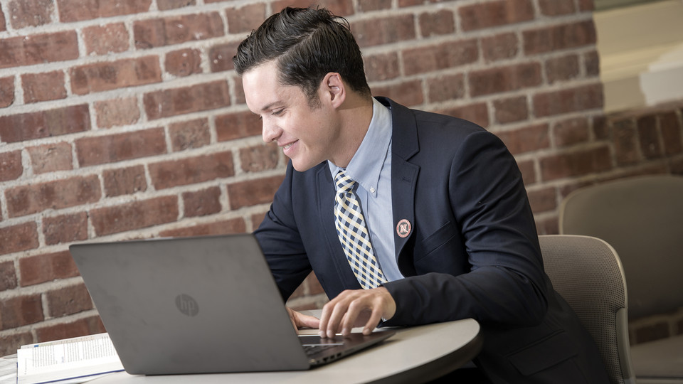 Russell Morgan, a Master of Business Administration student from Scottsbluff, Nebraska, studies in the College of Business Administration building. Nebraska's online MBA program was ranked the world's best value by Financial Times.