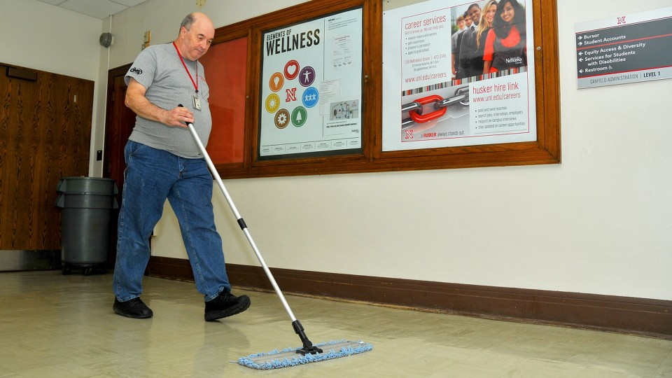 Bill Messman, a Custodial Services employee who has worked at UNL for 40 years, sweeps on the first floor in Canfield Administration Building on Sept. 15. UNL's cleaning crew met all criteria to receive re-certification with honors from the International Sanitary Supply Association.