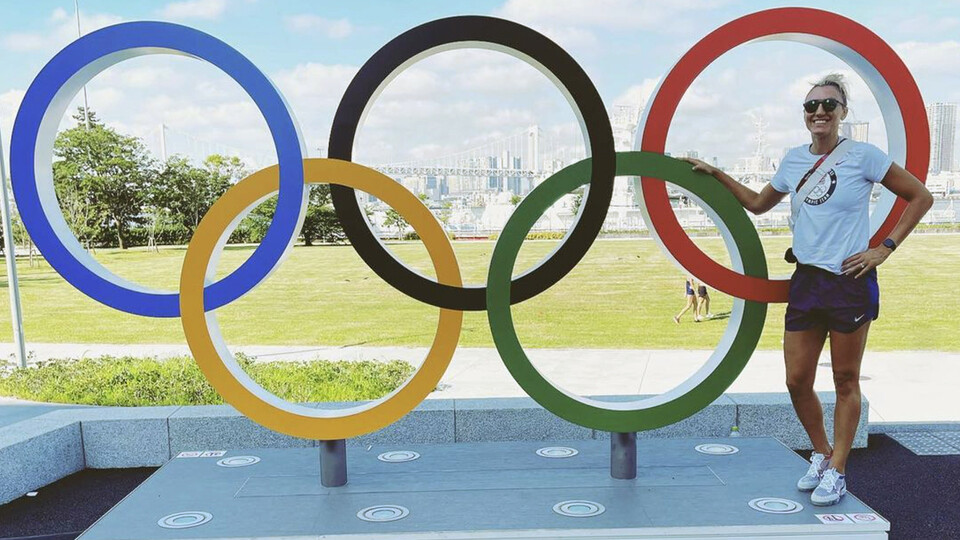 Nebraska's Jordan Larson stands next to the Olympic rings in Tokyo. Larson is playing in her third Olympics, having earned silver in 2012 and bronze in 2016 as part of Team USA's women's volleyball team.