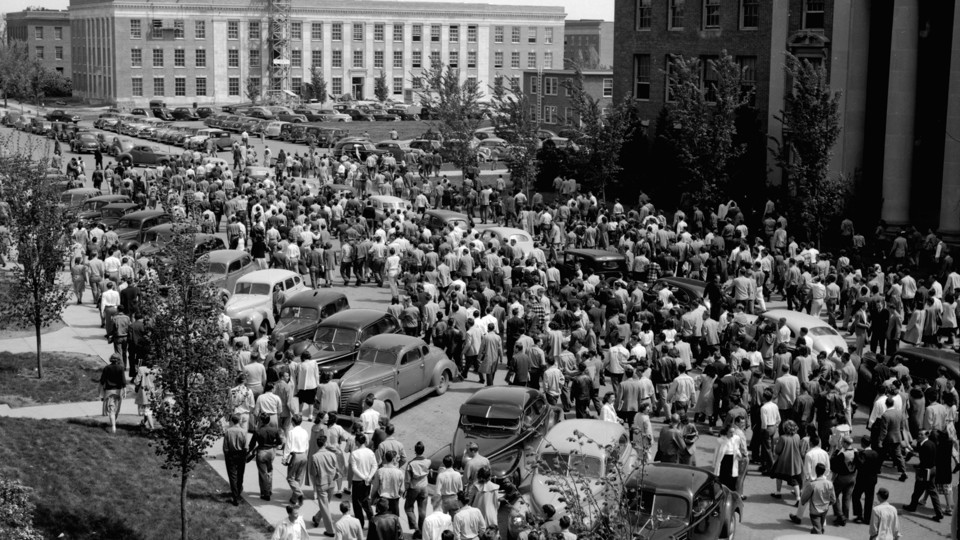 """Students participate in the parking riot of 1948. The riot started due to a lack of on-campus parking spaces. The riot started after student veterans, recently returned from World War II, confronted police who were ticketing cars that were double parked on streets. The police responded with tear gas. The students ended up marching around campus before parading down O Street in their cars. This image is included in Kay Logan-Peters' new book, """"University of Nebraska–Lincoln."""""""
