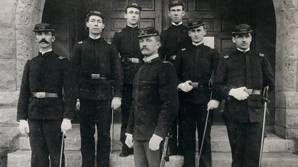 John J. Pershing poses with Nebraska U cadets during his tenure on campus. Pershing will be honored as part of new World War I service plaques being installed in Memorial Stadium.