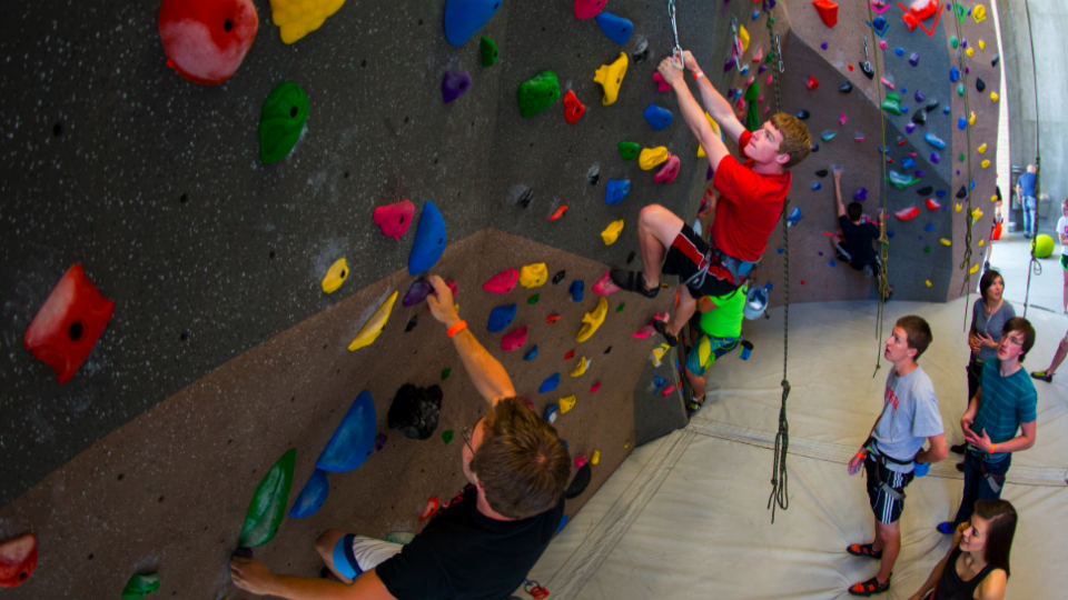 Students try out the new Outdoor Adventures Center climbing wall during the May 1 open house. The facility opens to the public today (May 5).