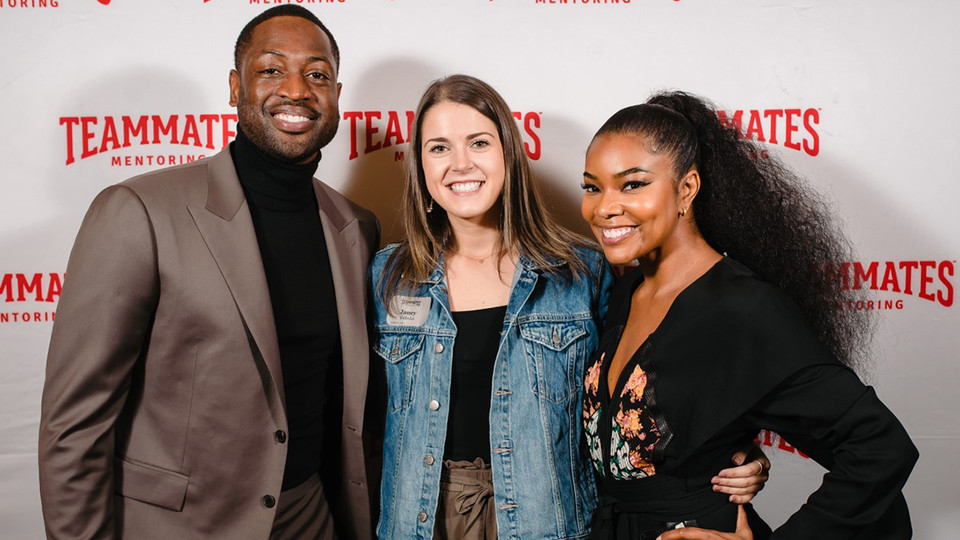 Nebraska alumna Janey Malcolm (center) stands with Dwyane Wade (left) and Gabrielle Union during a September Teammates event in Omaha.