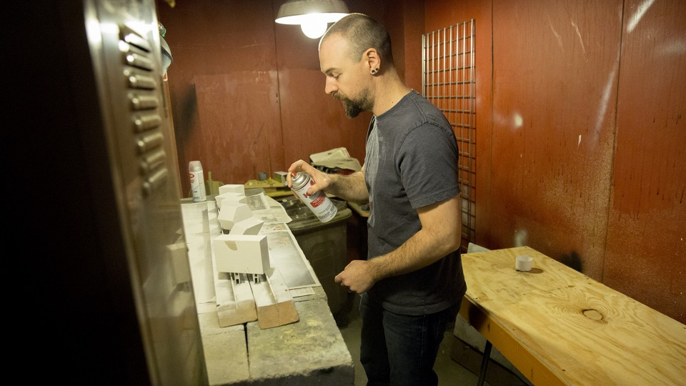 UNL's West Schomer paints concrete shapes that will be used for a crystal display in the University of Nebraska State Museum. Schomer will donate a kidney to Dustin Curry, his longtime friend and brother-in-law, on Nov. 19.